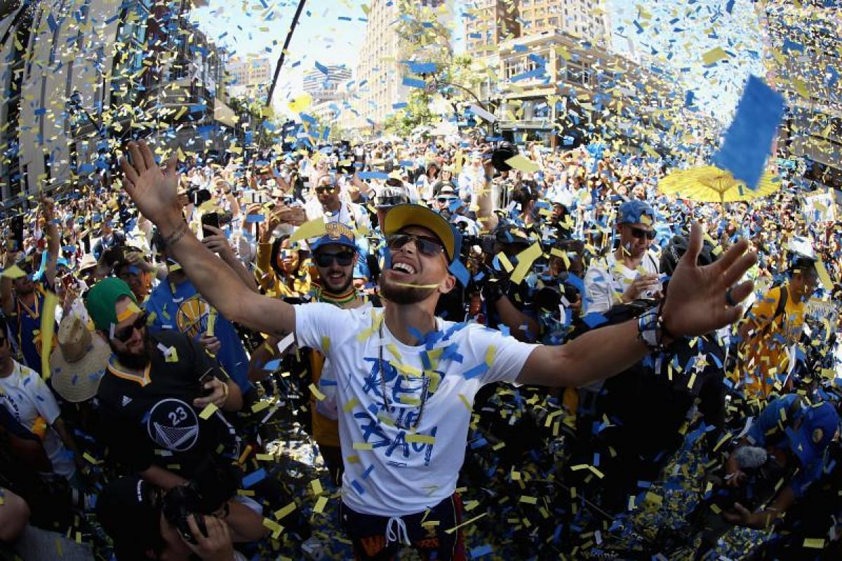 Stephen Curry of the Golden State Warriors celebrates with the crowd during the Golden State Warriors Championship parade on June 12, 2018.