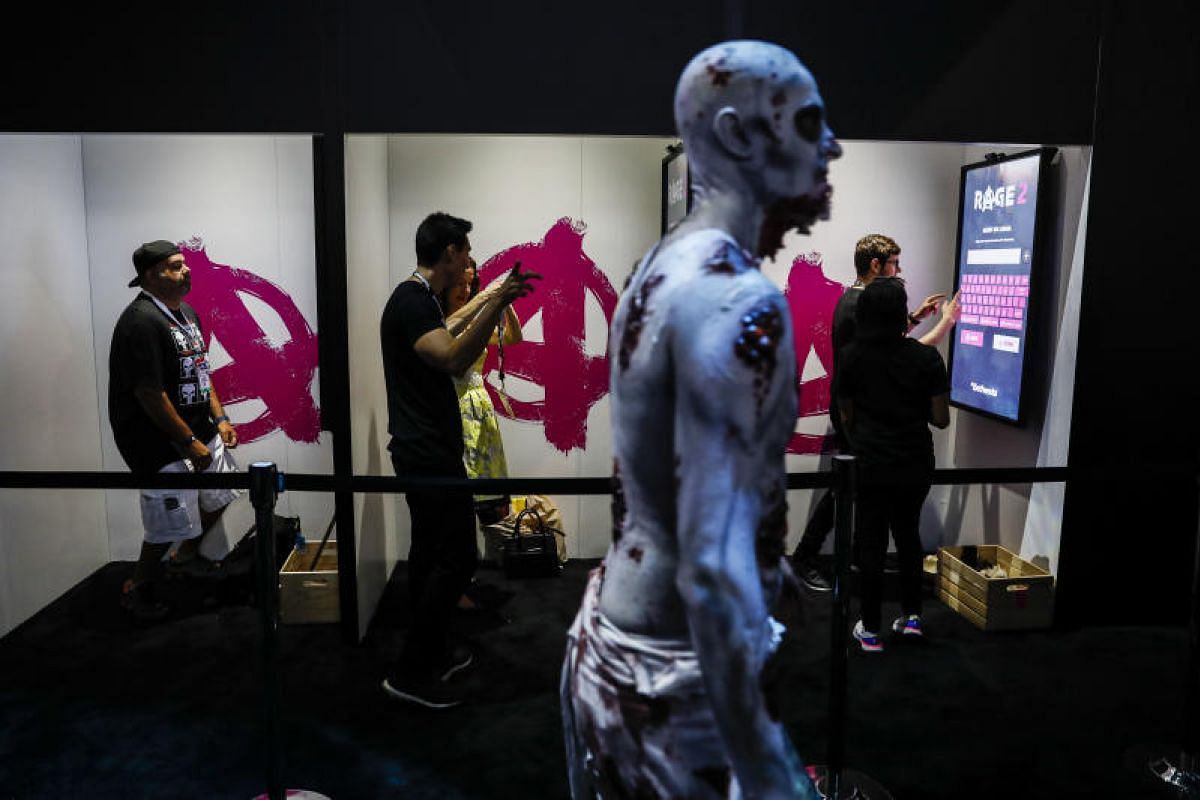 Attendees playing Bethesda Softworks' Rage 2 video game in Los Angeles at E3.