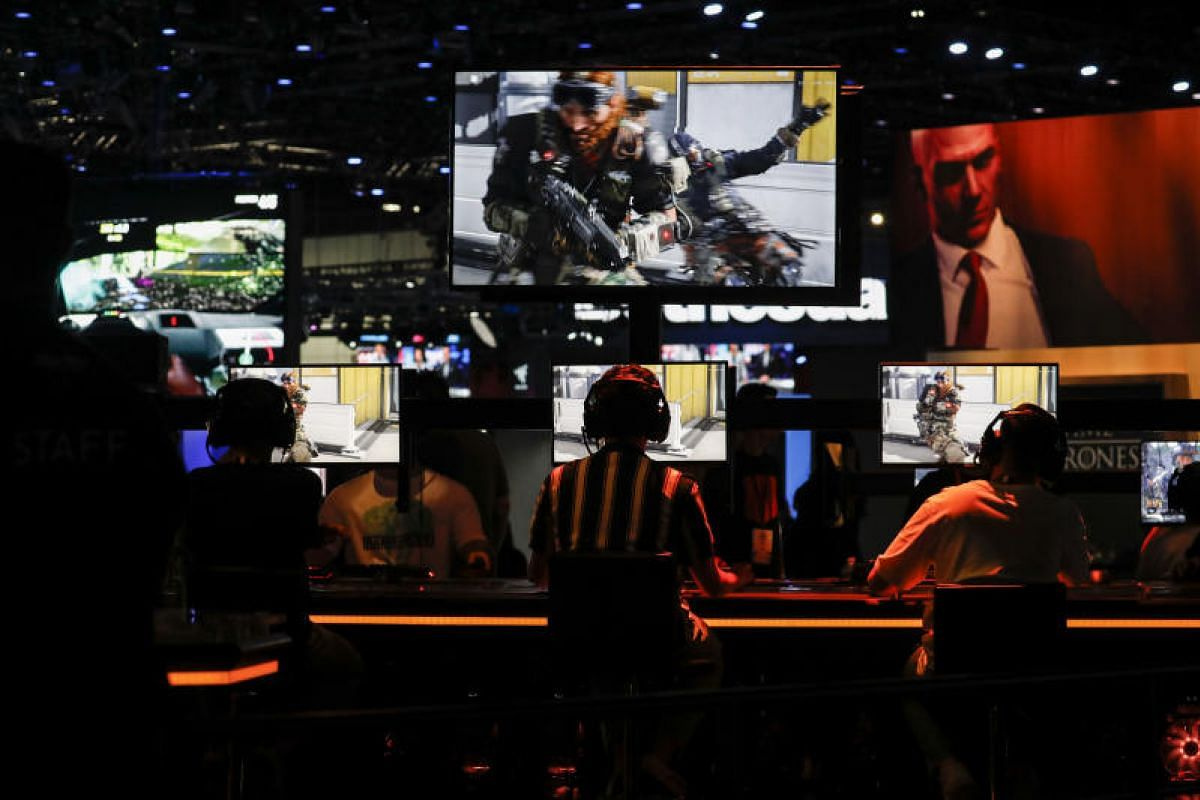 Attendees plaing Activision Blizzard Inc.'s latest blockbuster video game, Call of Duty: Black Ops 4 at E3.