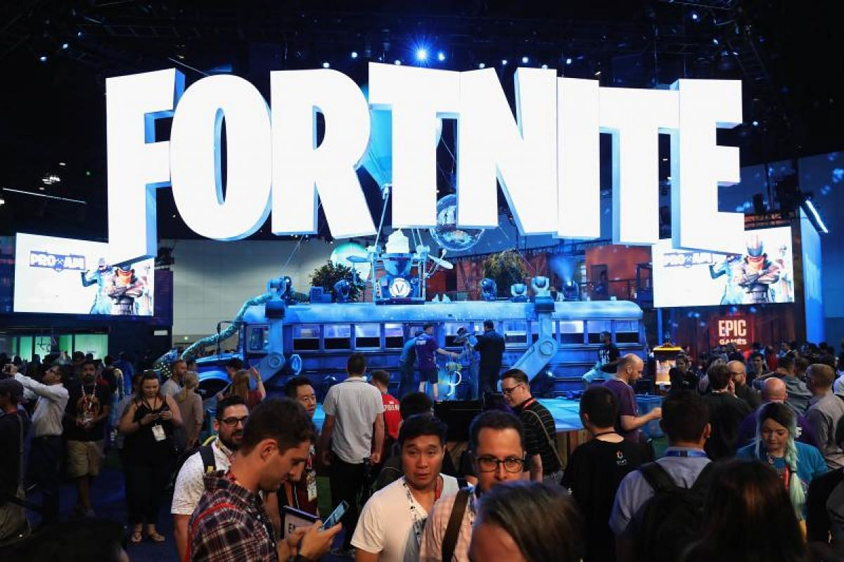 Game enthusiasts and industry personnel visiting the exhibit of Fornight, a massive popular video game published by Epic Games at E3.