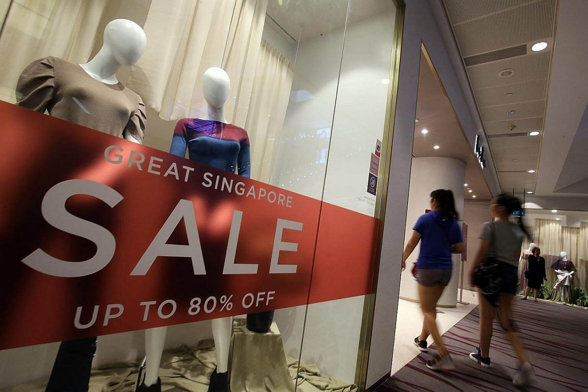 Shoppers entering a store participating in the Great Singapore Sale at 313 orchard, on June 6, 2018.