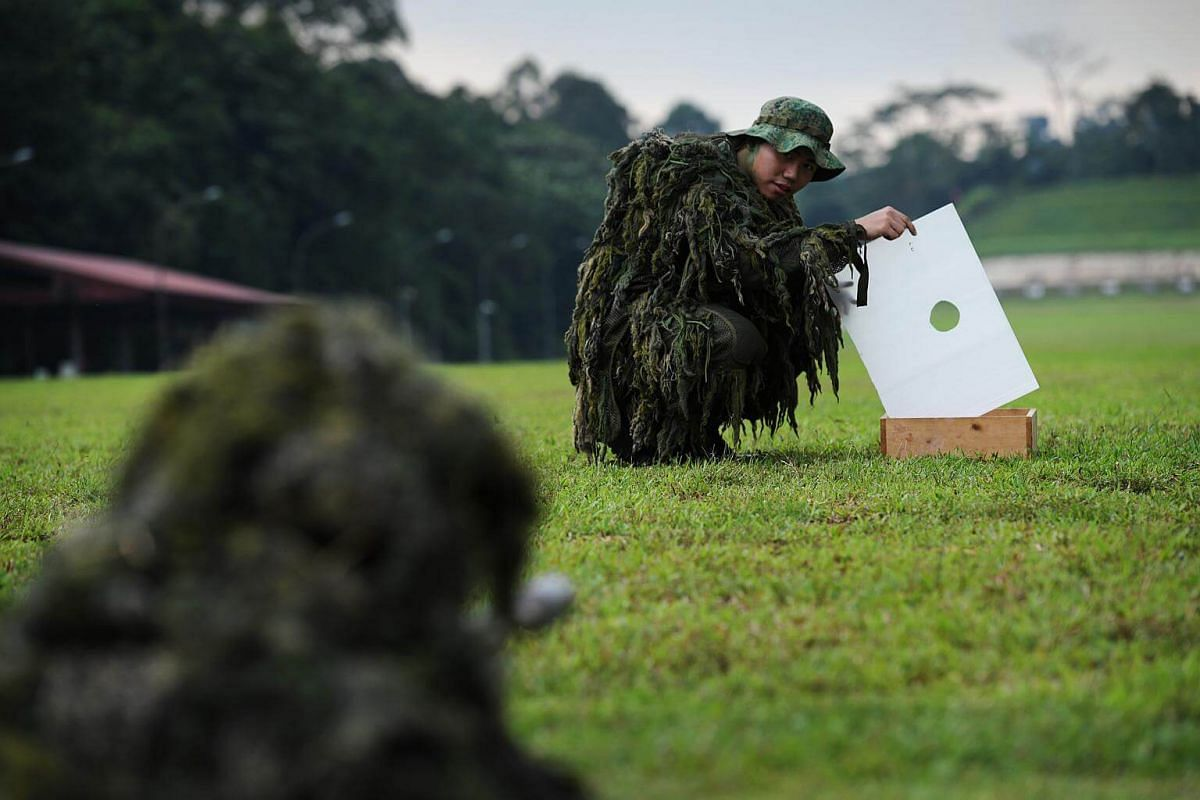 """Snipers shooting through a """"loophole"""" during the advanced course. Random openings in the environment that allow bullets to cleanly pass through, """"loopholes"""" help to conceal a sniper's actual shooting position by breaking up his outline. The bullet'"""