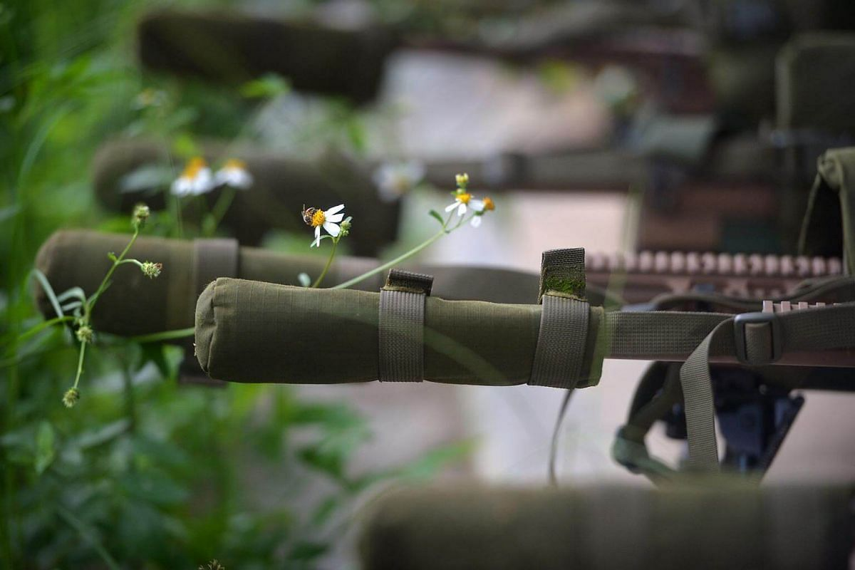 Sniper rifles are lined up into a row before a day of shooting begins at the Nee Soon 500-metre range.