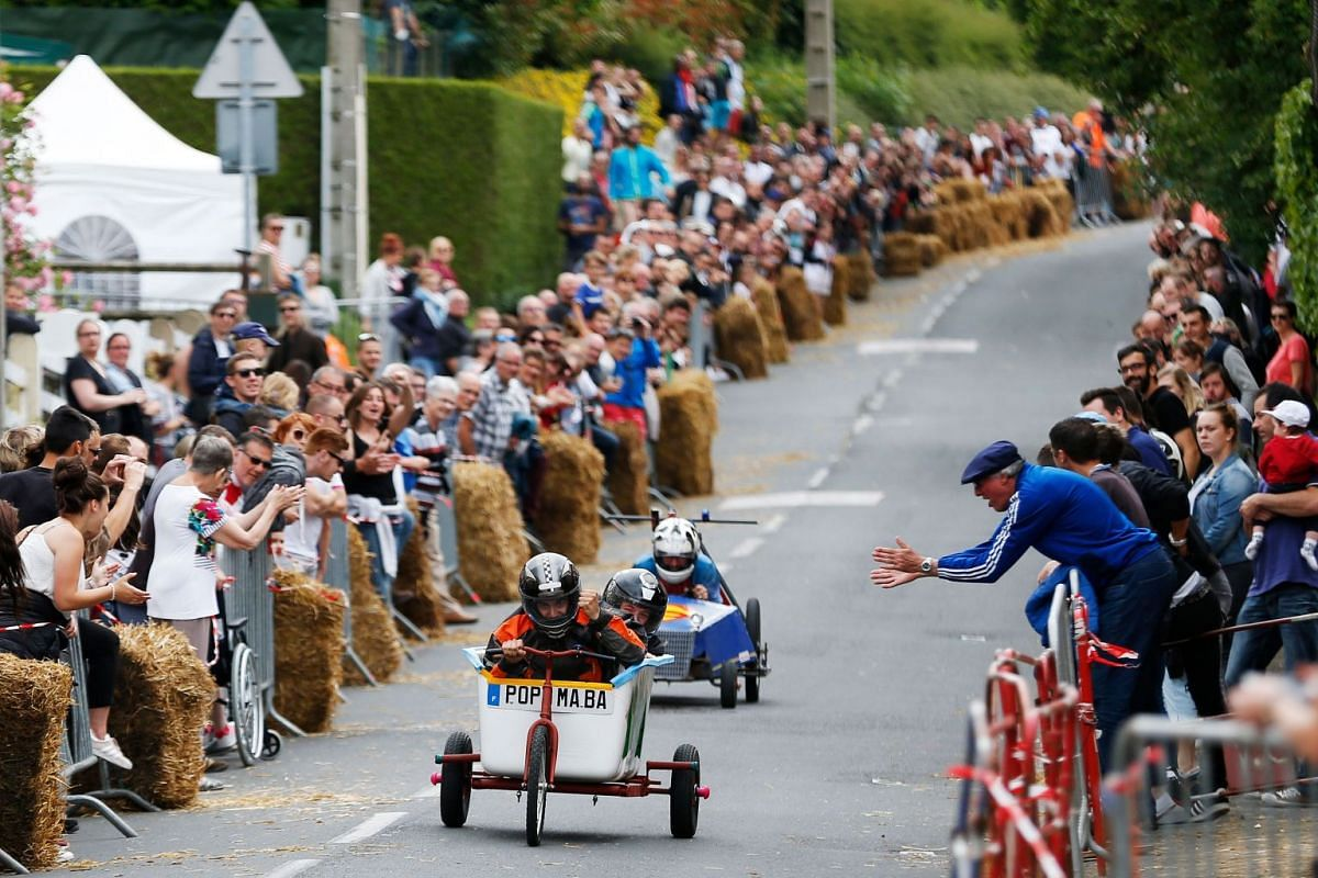 Participants compete during a soap box derby in Colombelles, near Caen, northwestern France, on June 17, 2018.