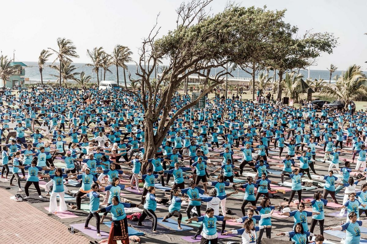 Hundreds of people take part in a yoga session at North Beach on June 17, 2018 in Durban, South Africa, ahead of the International Day of Yoga on June 21.