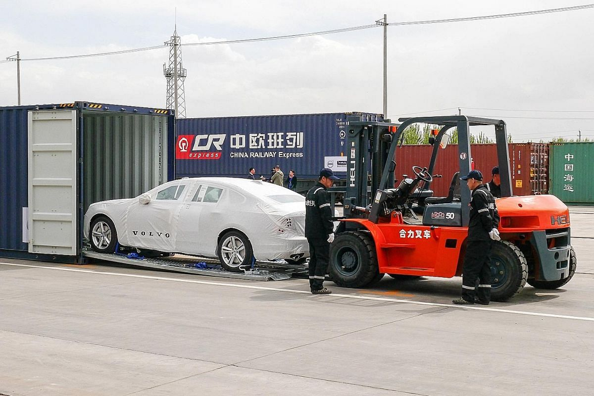 A Volvo S90 sedan being loaded into a container bound for Europe. The Swedish car maker has a plant in Daqing, Heilongjiang province. On May 21, the first China-Europe logistics train that originated from Hamburg, Germany, arrived at the Xi'an Railwa