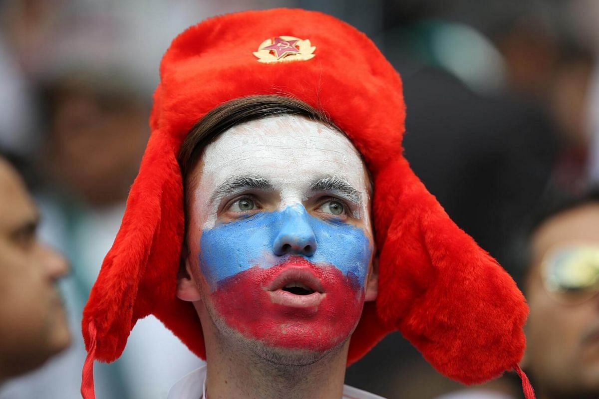 With his face painted in the colors of the Russian flag, a proud fan sings during the opening ceremony for the Russia 2018 World Cup at the Luzhniki stadium in Moscow, on June 14, 2018.