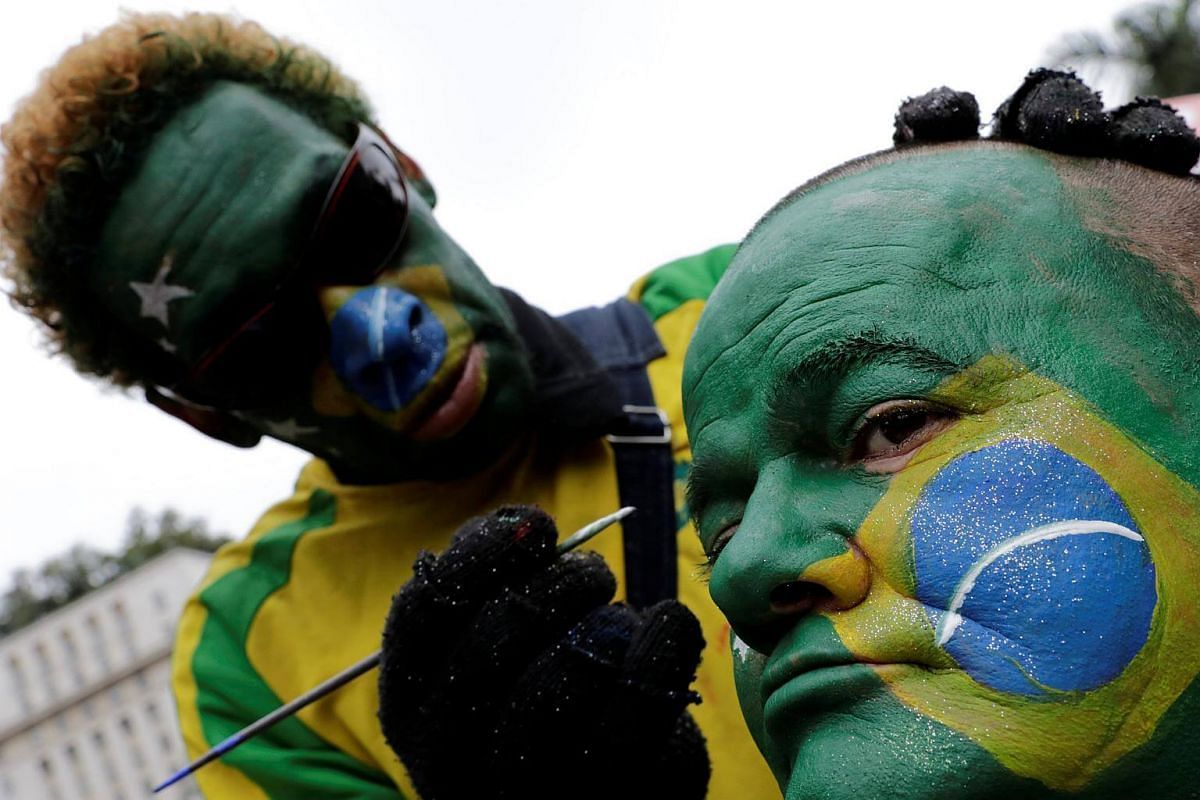 A Brazil fan having the Brazillian flag painted on his face in downtown Sao Paulo, Brazil, before the opening ceremony and first match of the the Russia 2018 World Cup, on June 14, 2018.