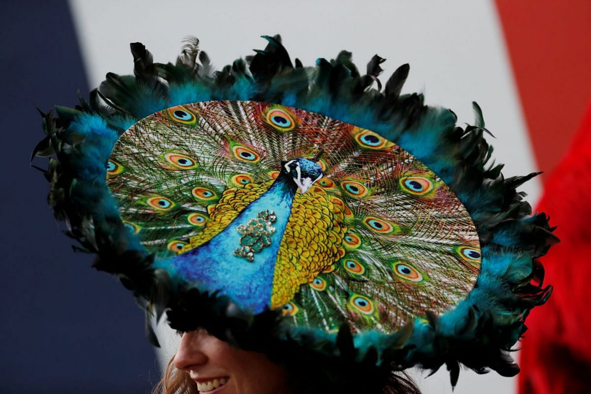 A racegoer dons a fancy hat at the Ascot Racecourse during the Royal Ascot in Britain, on June 19, 2018. PHOTO: REUTERS