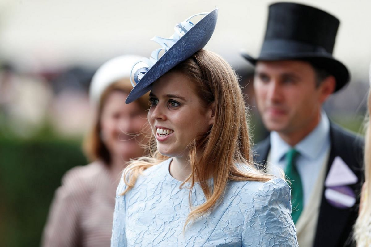 Princess Beatrice seems to have gotten the family's memo on monochrome dressing, topping it off with what looks like a satellite dish on her head. PHOTO: REUTERS