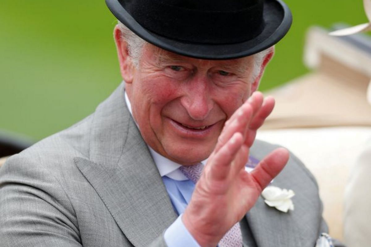 Prince Charles looks very dapper in his grey ensemble, perked up by a pink tie and dainty boutonniere. PHOTO: REUTERS