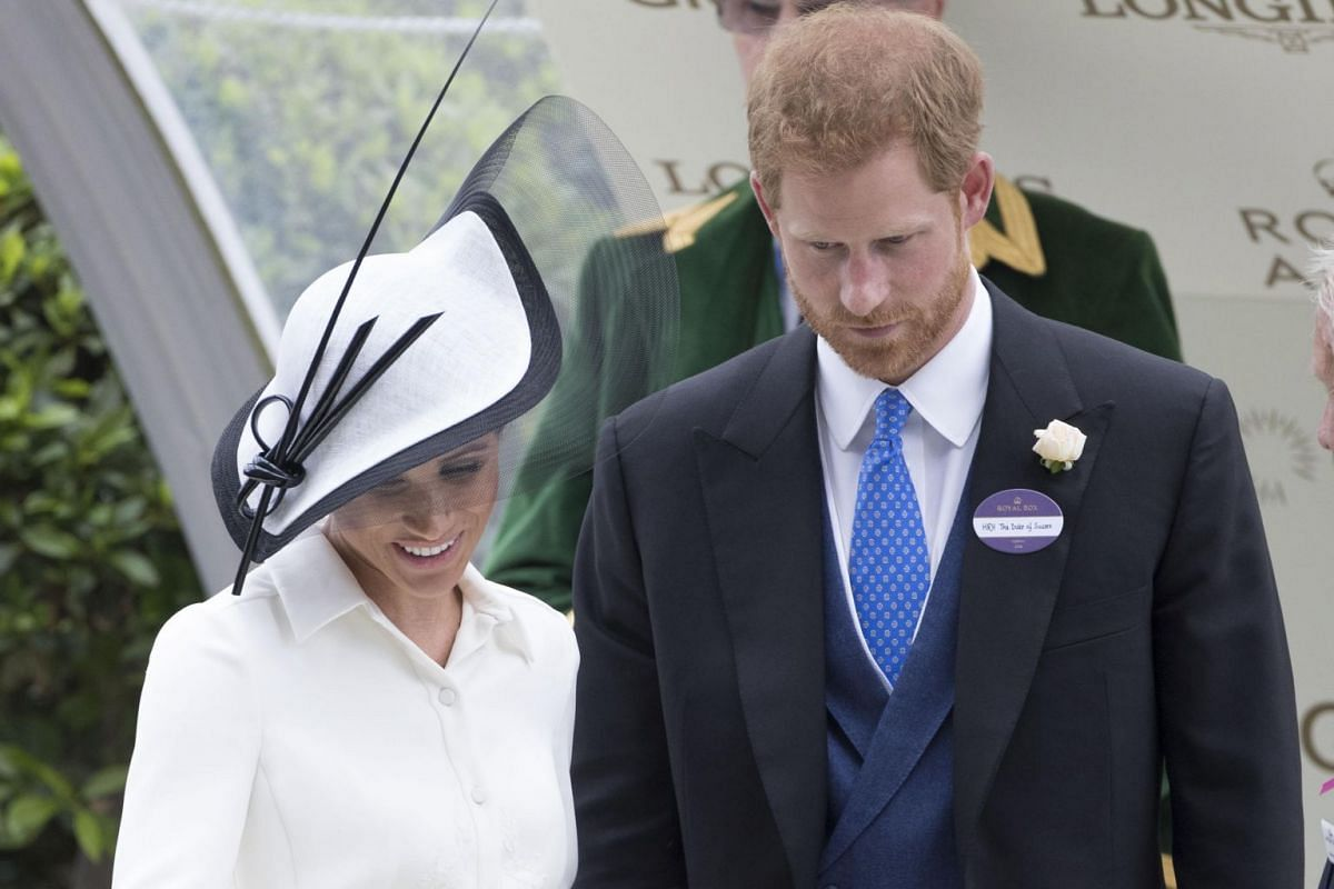 Newly minted Duchess of Sussex Meghan Markle makes a fairly muted debut at Royal Ascot in a simple white Givenchy dress with embossing detail and a streamlined hat by Philip Treacy.