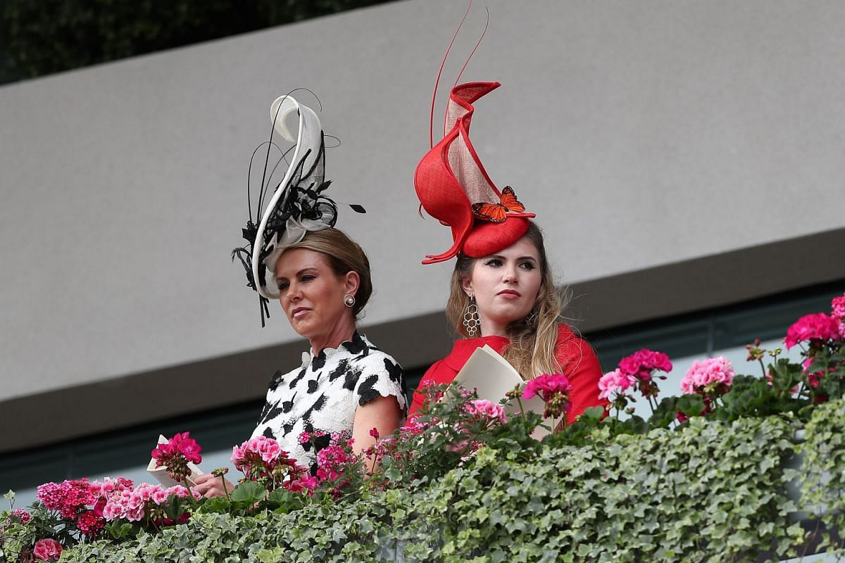 How tall can a fascinator go? These two racegoers defy gravity with their headgear. PHOTO: AFP
