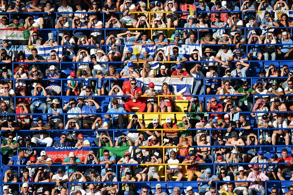 Football fans follow the Russia 2018 World Cup Group A football match between Uruguay and Saudi Arabia at the Rostov Arena in Rostov-On-Don on June 20, 2018.