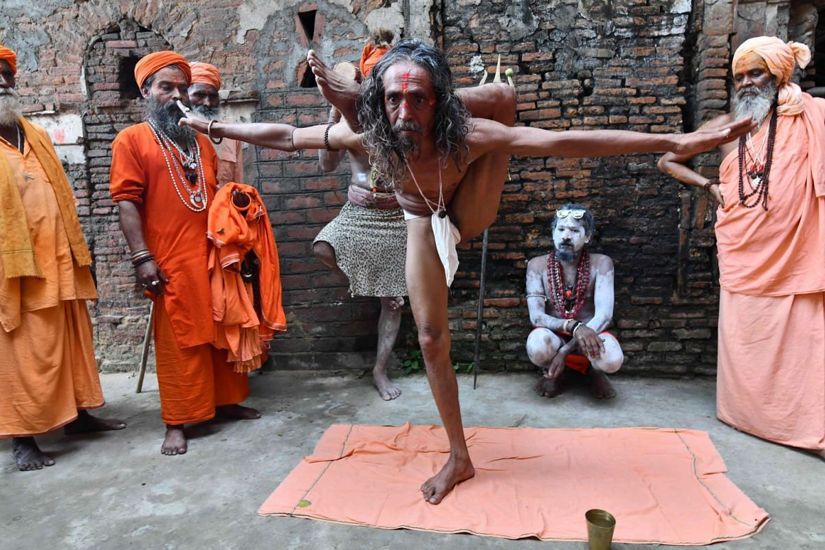 A Hindu holy man performs yoga to mark International Yoga Day at Kamakhya Temple in Guwahati in the Indian state of Assam on June 21, 2018.