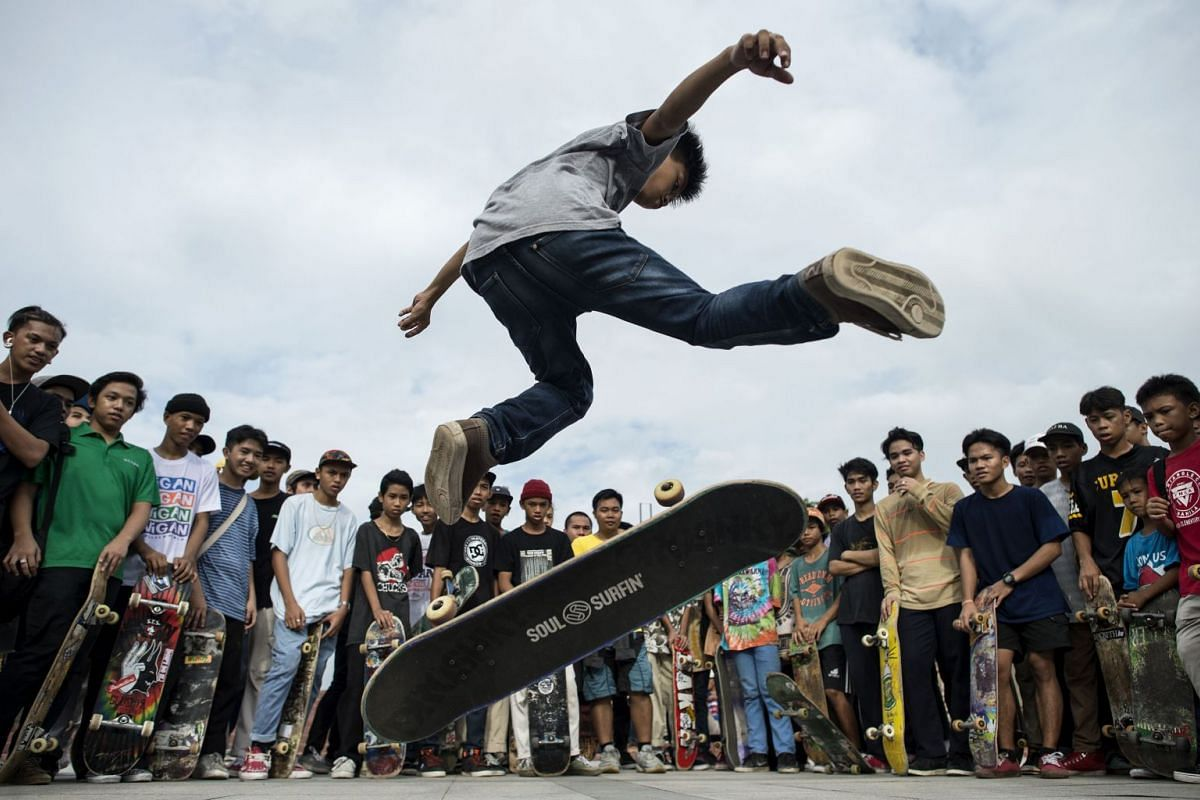 A boy demonstrates his skateboarding skills during an event to mark Go Skateboarding Day in Manila on June 21, 2018.