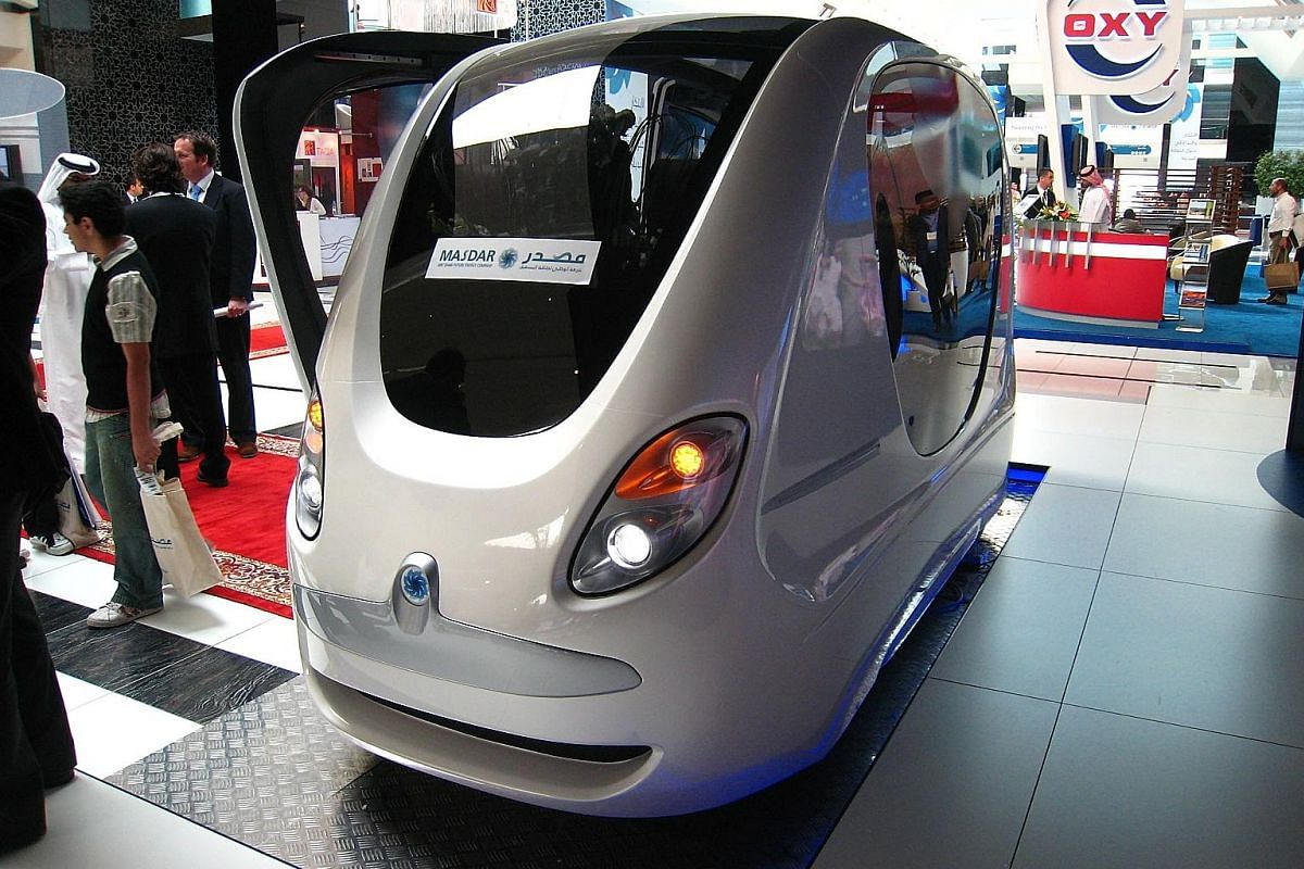 A model of the planned new capital for Egypt displayed for investors at the opening of the Egypt Economic Development Conference in 2015. A small capsule-shaped pod with no wheels and no driver, which runs along light rail lines, in Masdar City. Saud