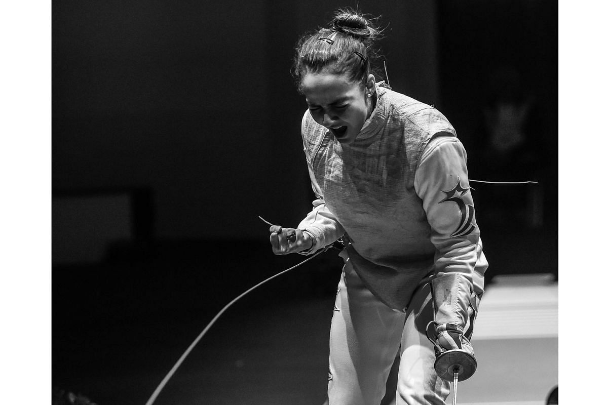 Amita Berthier, the world junior No. 3 fencer, listens to high-tempo music before she competes.