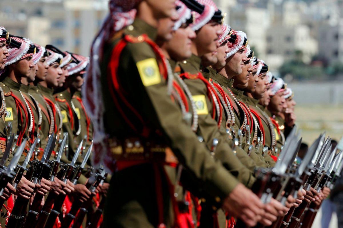 Jordanian honour guards preparing for the arrival of Britain's Prince William in Amman, Jordan, on June 24, 2018.
