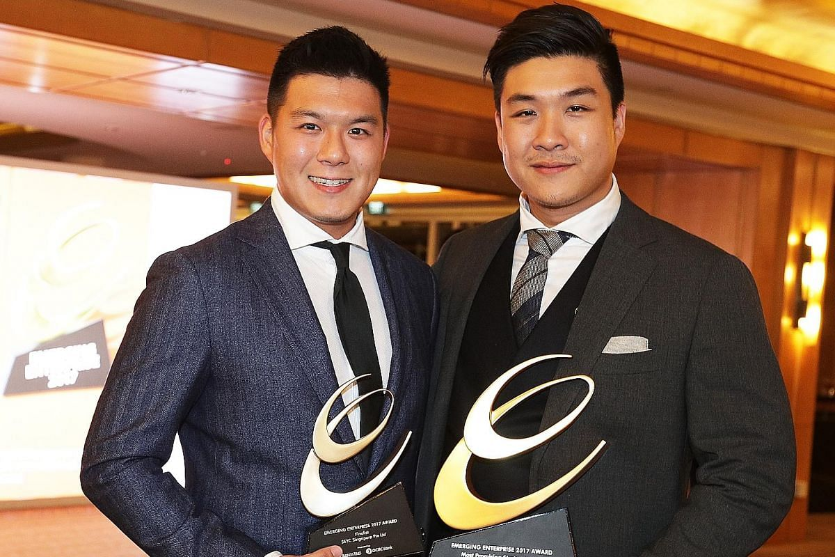 Mr Christopher Hwang (left) and Mr Jonathan Shen at their two-month-old store at Ion Orchard. They are working on new products with a new flavour. Mr Christopher Hwang (left) and Mr Jonathan Shen with their Most Promising Startup Award at the Emergin