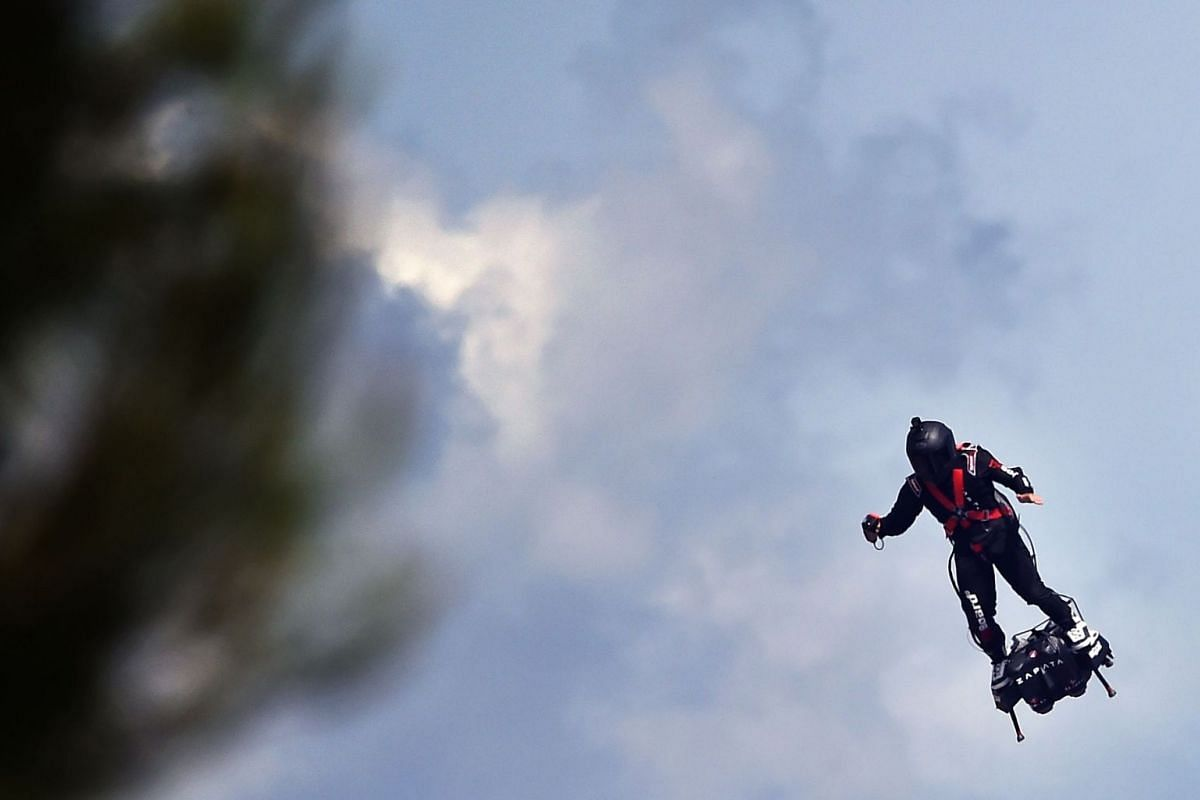 Zapata CEO Franky Zapata flying a jet-powered hoverboard or 'Flyboard', on June 24, 2018, ahead of the Formula One Grand Prix de France at the Circuit Paul Ricard in Le Castellet, southern France.