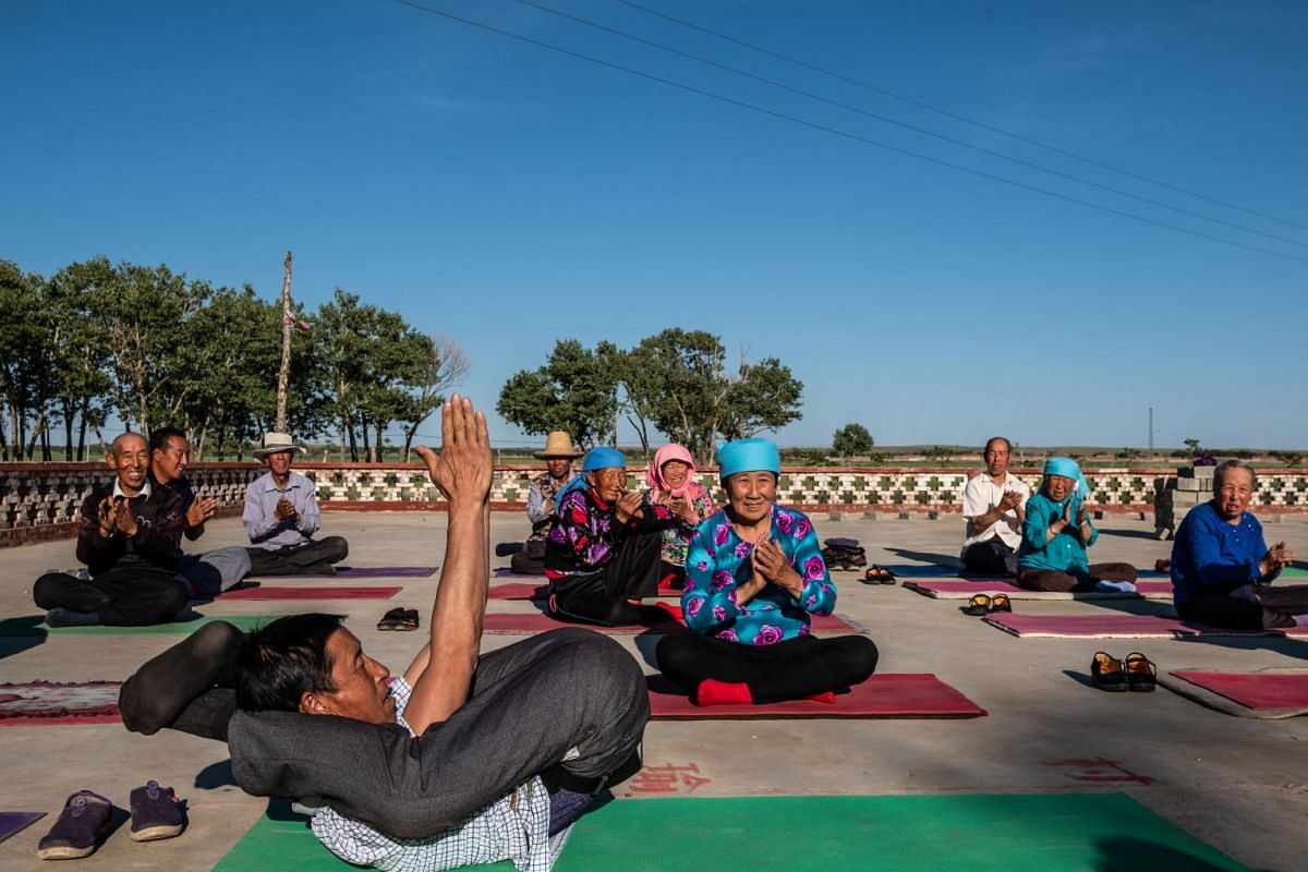 A yoga session at Yugouliang village in Hebei, China, on June 20, 2018. The local Communist Party chief has turned to yoga to bring health, vitality and tourism to the fading, remote hamlet.