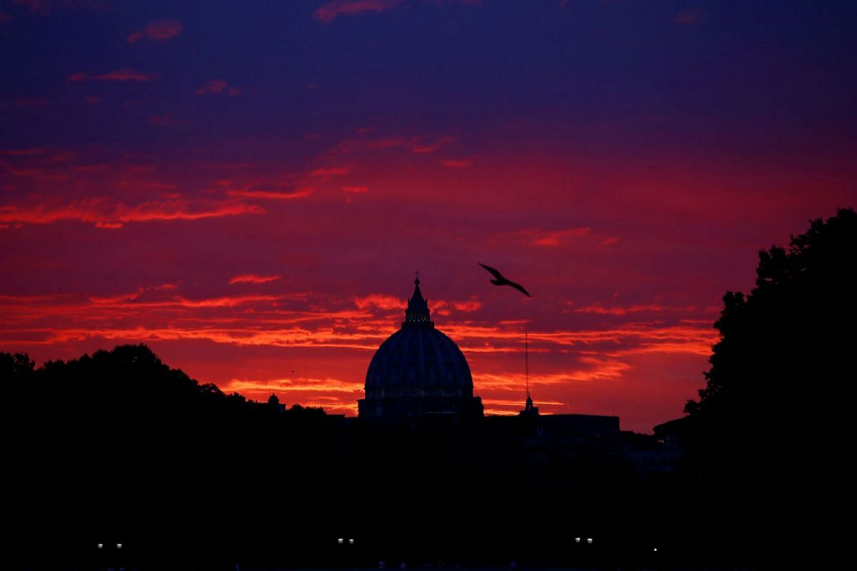 St. Peter's Basilica at the Vatican is seen at the sunset from Garibaldi bridge in Rome, Italy, on June 25, 2018.