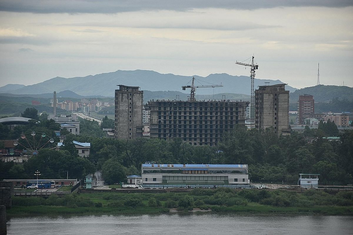 North Korea as seen from the Chinese border city of Dandong, separated by the Yalu River. Dandong residents are hopeful the city's fortunes, which are very much tied to North Korea, could rise again. Border trade has been hit hard by United Nations s