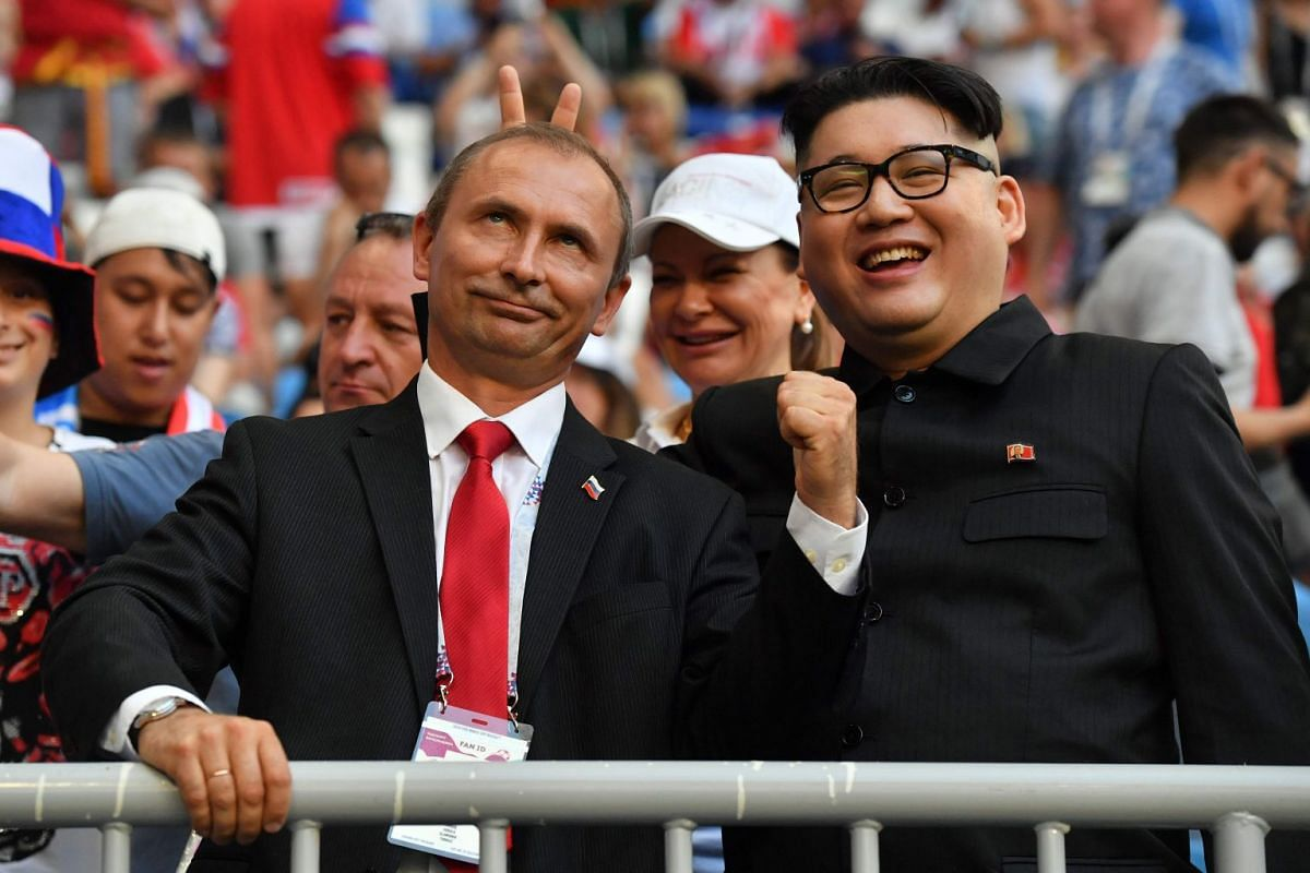 Impersonators of Russian President Vladimir Putin and North Korean leader Kim Jong Un posing during the Russia 2018 World Cup Group A football match between Uruguay and Russia at the Samara Arena in Samara, on June 25, 2018.