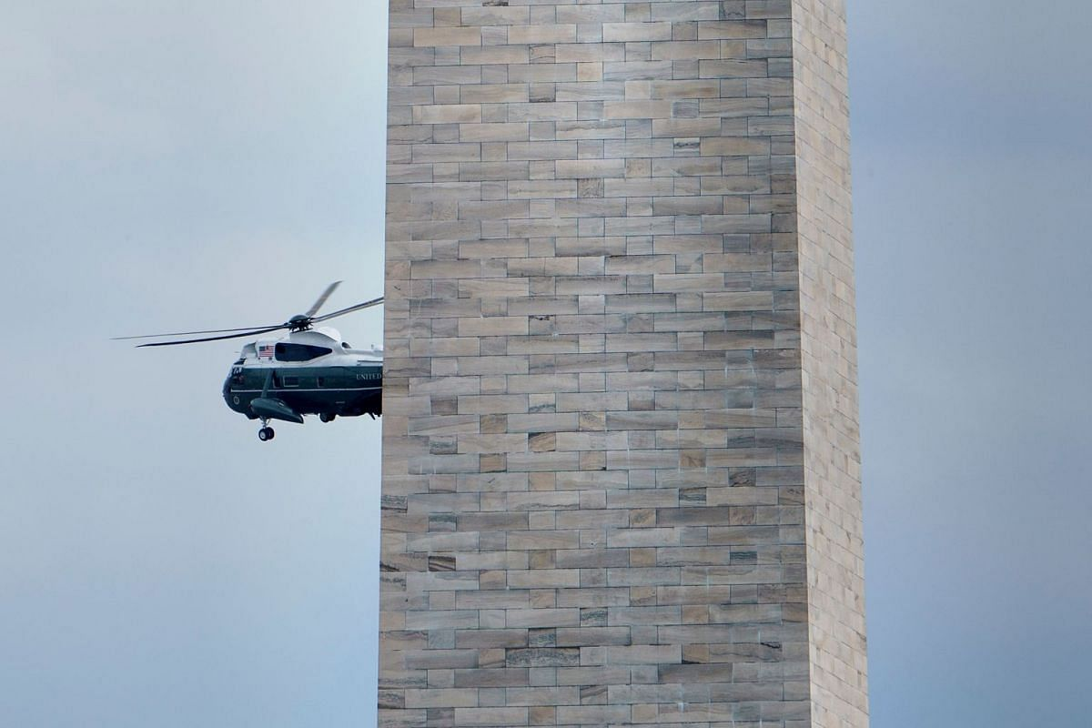 US President Donald Trump flies past the Washington Monument in Washington DC on the Marine One after departing the White House, on June 25, 2018.