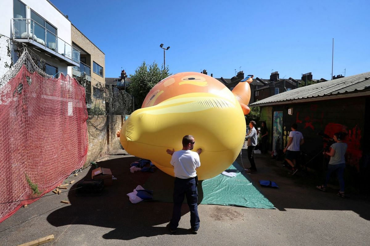A helium-filled blimp  of US President Donald Trump being inflated before its deployment during his upcoming visit to in London, UK, on June 26, 2018.