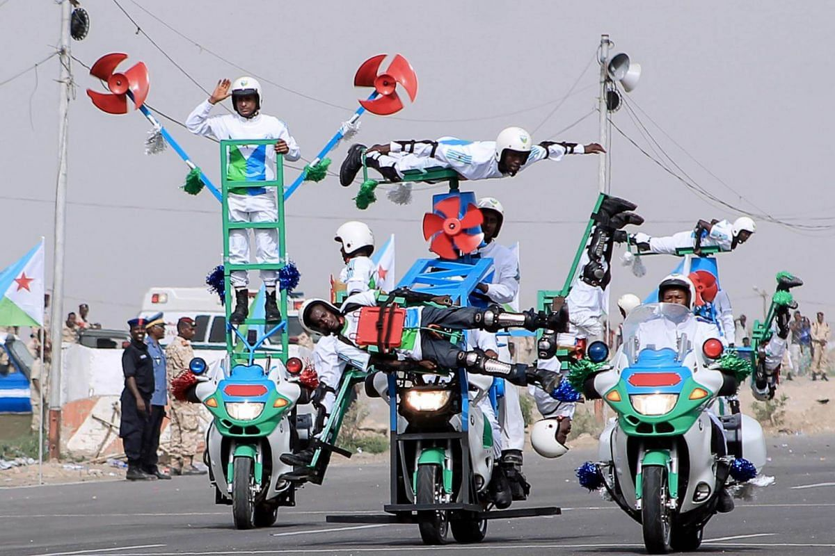 Police officers performing acrobatic stunts during a parade marking the 41st anniversary of Djibouti's independence in Djibouti, on June 27, 2018.