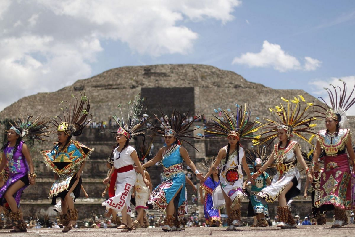 Women participating in a traditional dance during the new fire ceremony at the Teotihuacán pyramids in Mexico City, Mexico, where the cauldron is ignited and will travel to Colombia during the XXIII Central American and Caribbean Games of Barranquil