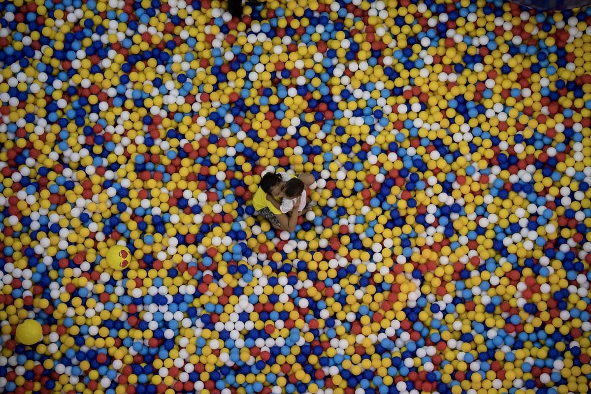 Children playing in a pool filled with small balls at a mall in Manila, the Philippines, on June 28, 2018.