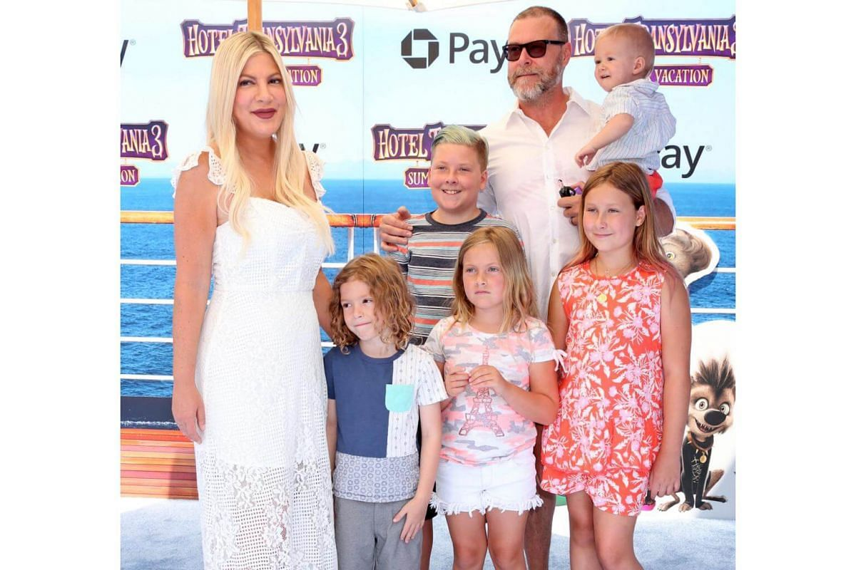Tori Spelling (left) and family arrive for the world premiere of Hotel Transylvania 3: Summer Vacation on June 30, 2018.