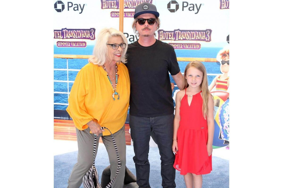 David Spade (centre), daughter Harper Spade (right) and Judith Spade arrive for the world premiere of Hotel Transylvania 3: Summer Vacation on June 30, 2018.