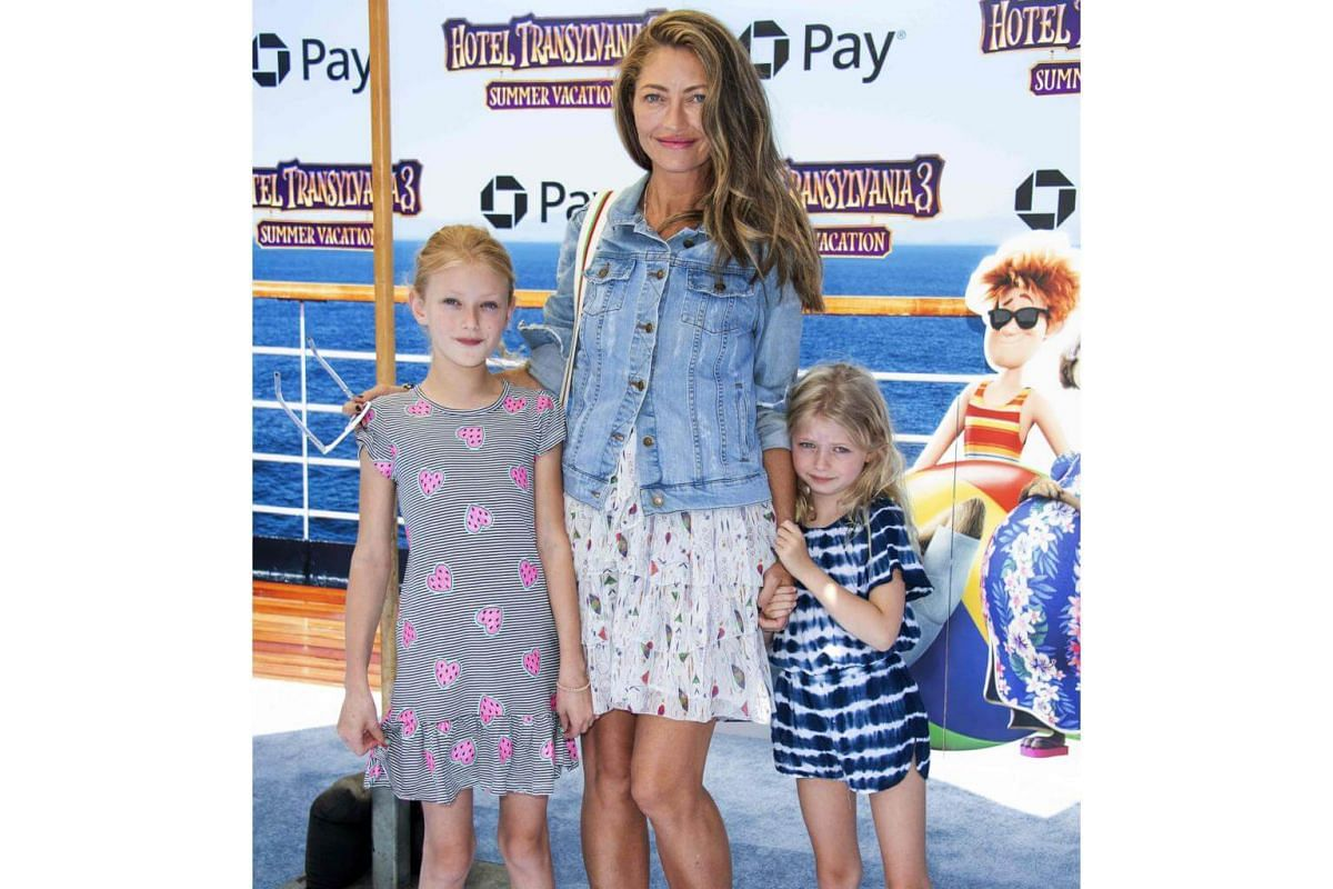 (From left) Billie Beatrice Dane, Rebecca Gayheart, and Georgia Dane arrive for the world premiere of Hotel Transylvania 3: Summer Vacation on June 30, 2018.