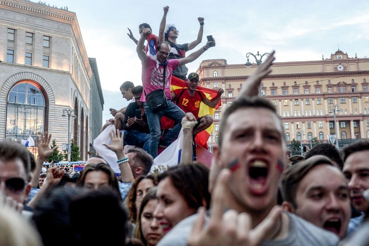 Russia's fans react after Russia won the Russia 2018 World Cup round of 16 football match against Spain in central Moscow, on July 1, 2018.