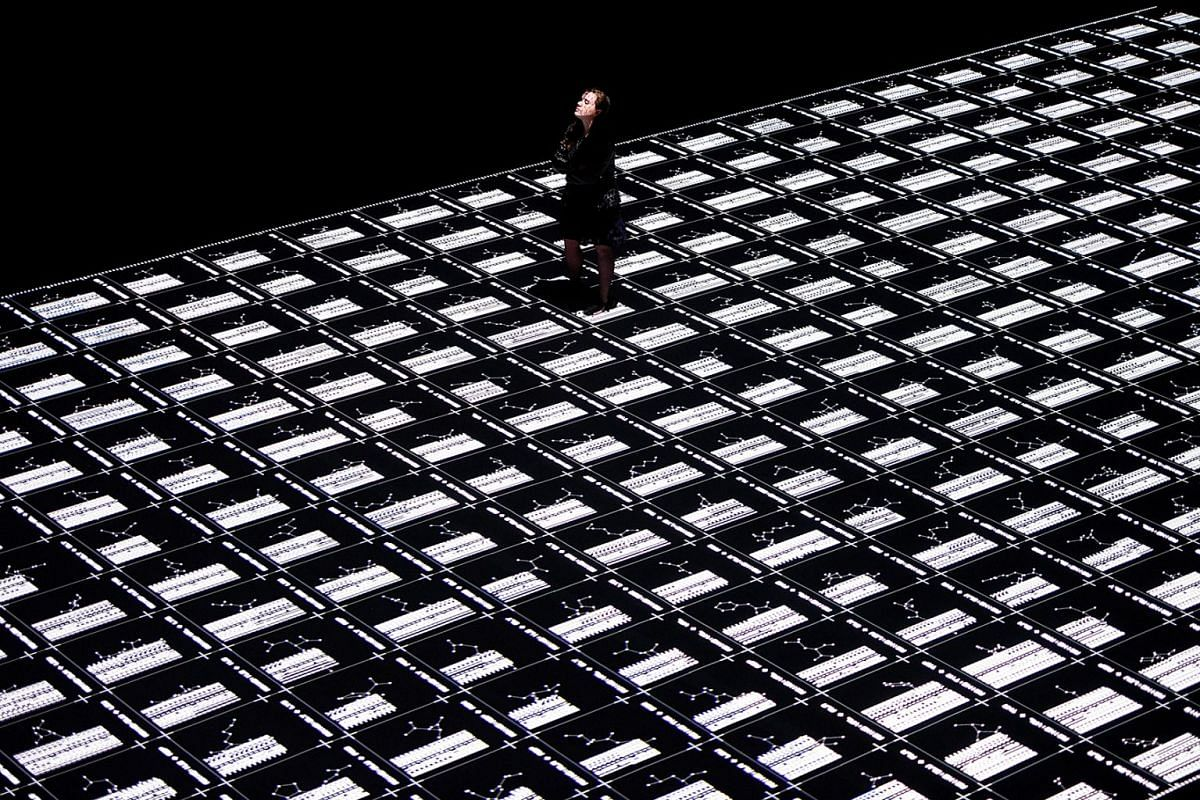 A visitor attends a media preview of the audio-visual installation entitled 'micro / macro' by Japanese visual artist Ryoji Ikeda at Carriageworks in Sydney, Australia, 03 July 2018. The installation is open to public from 04 to 29 July.
