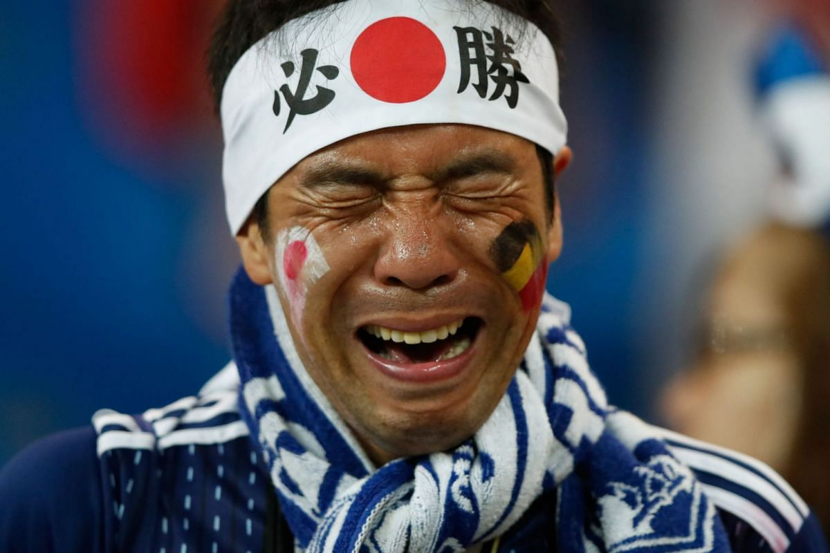 A fan of Japan cries at the end of the Russia 2018 World Cup round of 16 football match between Belgium and Japan at the Rostov Arena in Rostov-On-Don on July 2, 2018. Belgium won 3-2.