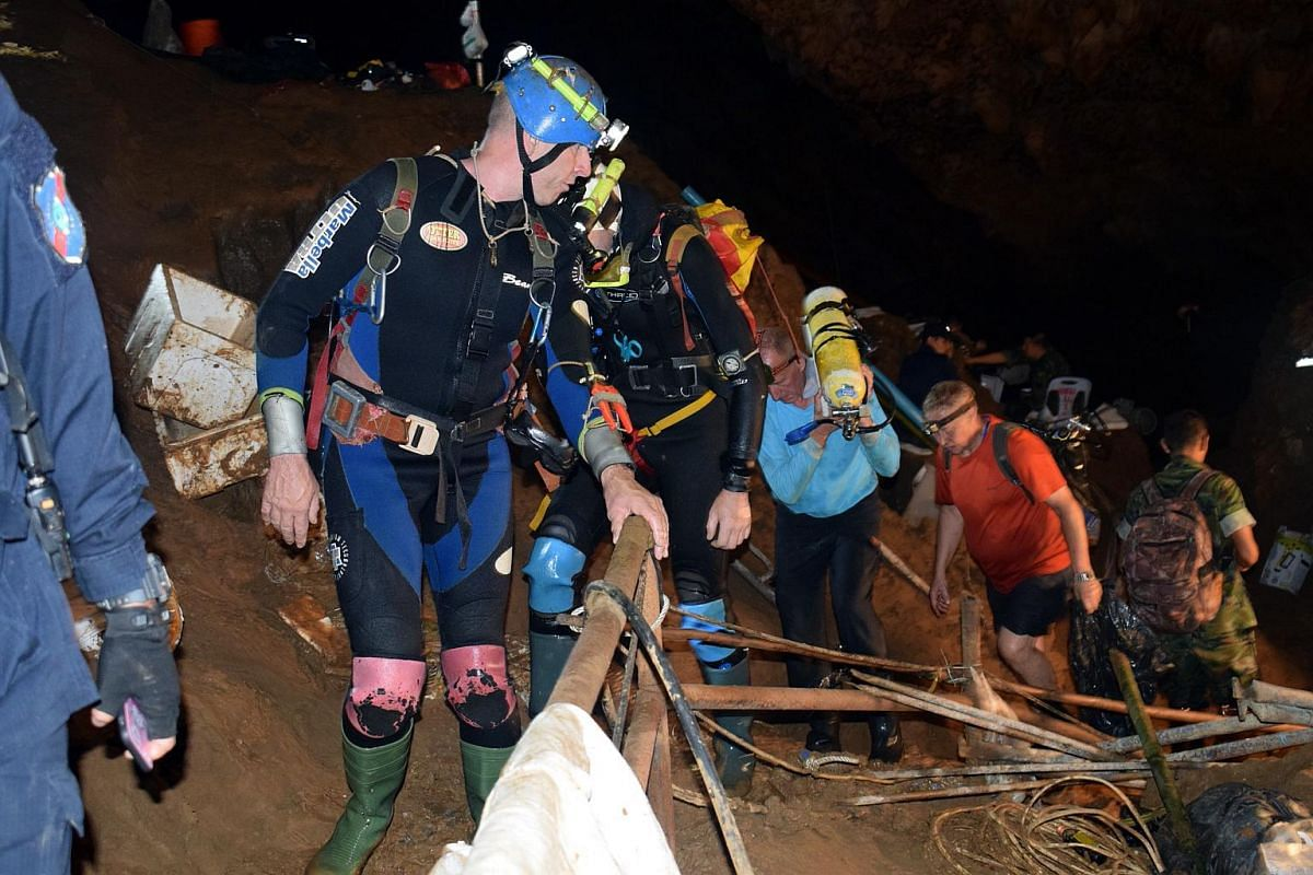 Foreign divers with rescue equipment preparing for a search operation for the missing youth soccer team and their coach at Tham Luang cave in Khun Nam Nang Non Forest Park, Chiang Rai province, Thailand, in a photo released on July 2, 2018.
