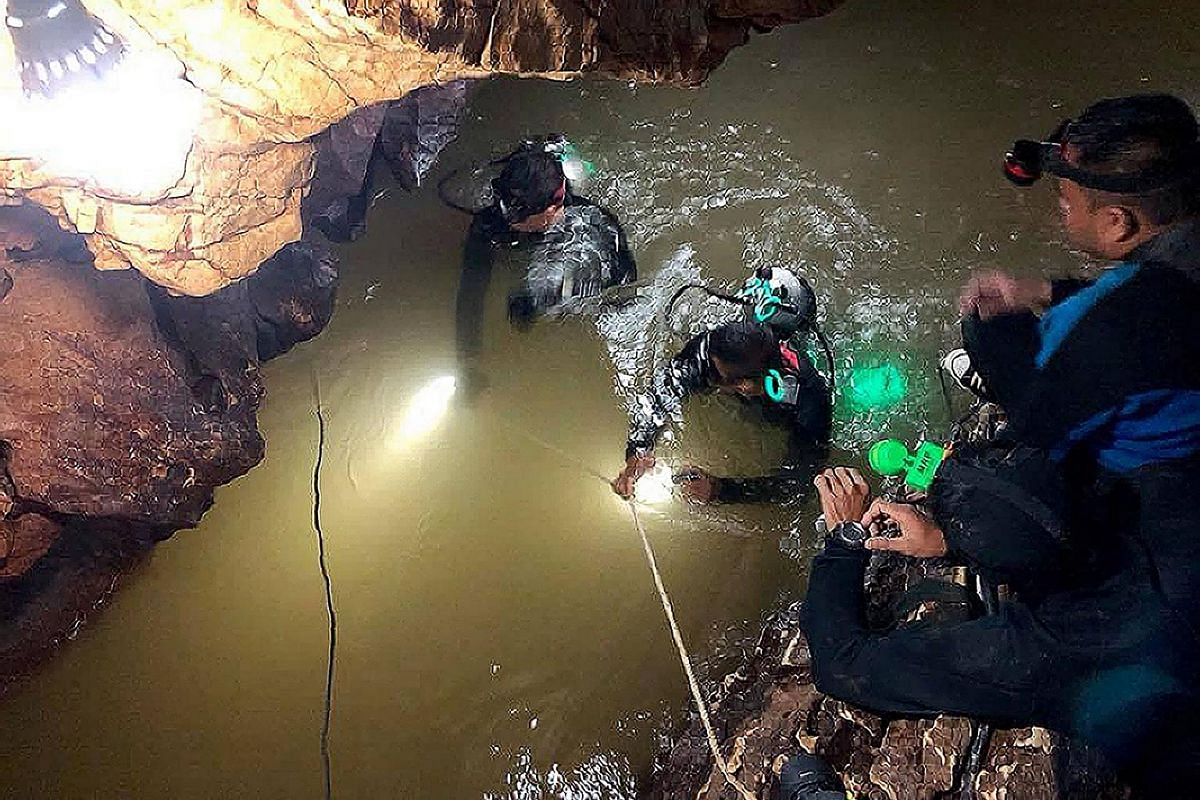 A team of Royal Thai Navy SEAL divers inspecting the water-filled tunnel in the Tham Luang cave during a rescue operation for the missing children's football team and their coach in Chiang Rai province, on June 28, 2018.