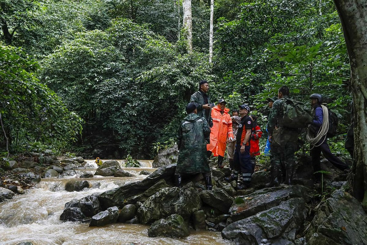 A team of Thai officials seen on the mountain of Khun Nam Nang Non Forest Park in Chiang Rai province. They were searching for new openings to Tham Luang cave during a rescue operation for the missing children's football team and their coach, on June