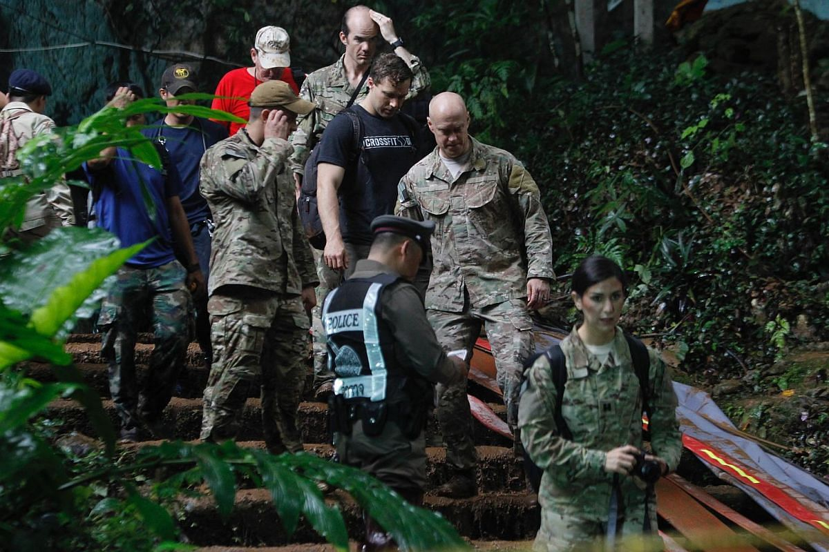 Members of the US Special Operations Command Pacific Search and Rescue Team surveying the cave area as they join the rescue operation for the missing football players and their coach at the Tham Luang cave, on June 28, 2018.