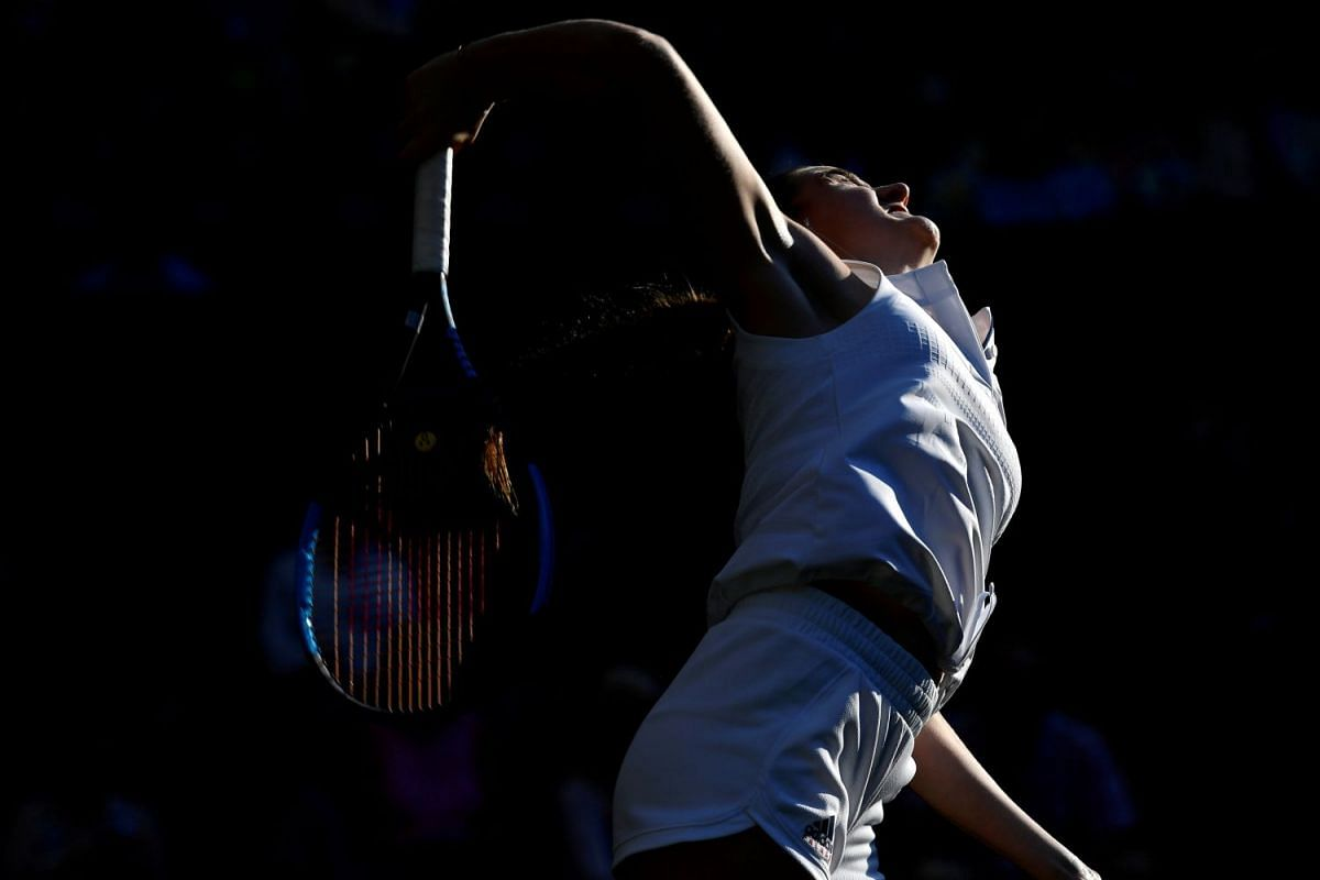 England's Katy Dunne in action as she competes against Jelena Ostapenko of Latvia during their first round match of the Wimbledon All England Lawn Tennis and Croquet Club, in London, UK, on July 3, 2018.