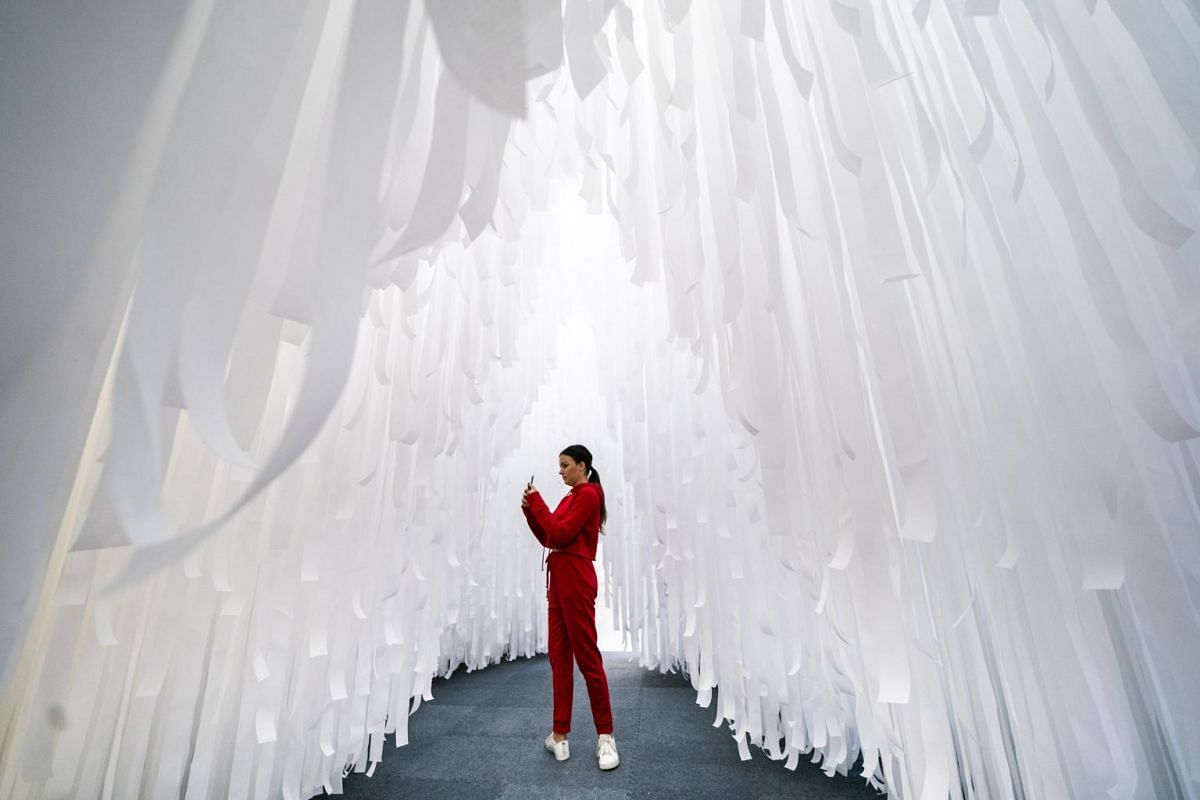 A visitor taking photographs inside the exhibit Fun House, the latest of the Summer Block Party installations at the National Building Museum in Washington DC, US, on July 3, 2018. The heart of the exhibit, which officially opens the day after, is a