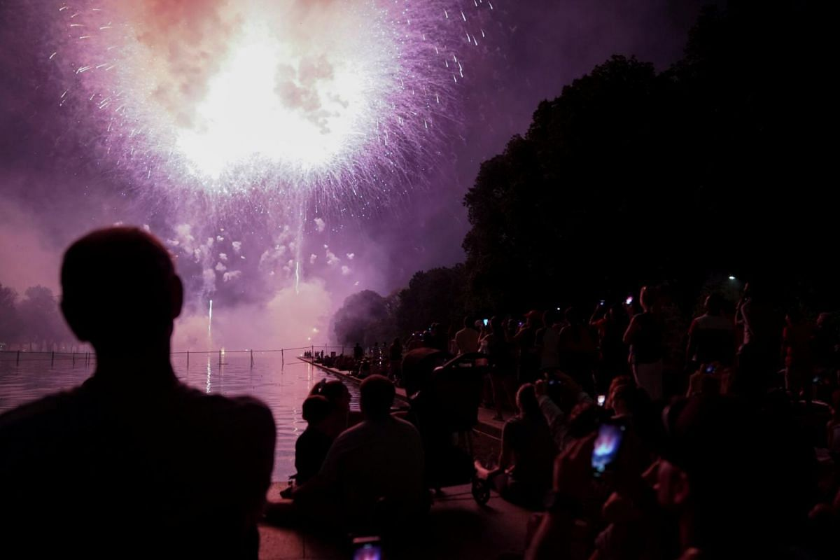 People watch fireworks during the 4th of July Independence Day celebrations at the National Mall in Washington DC on July 4, 2018.