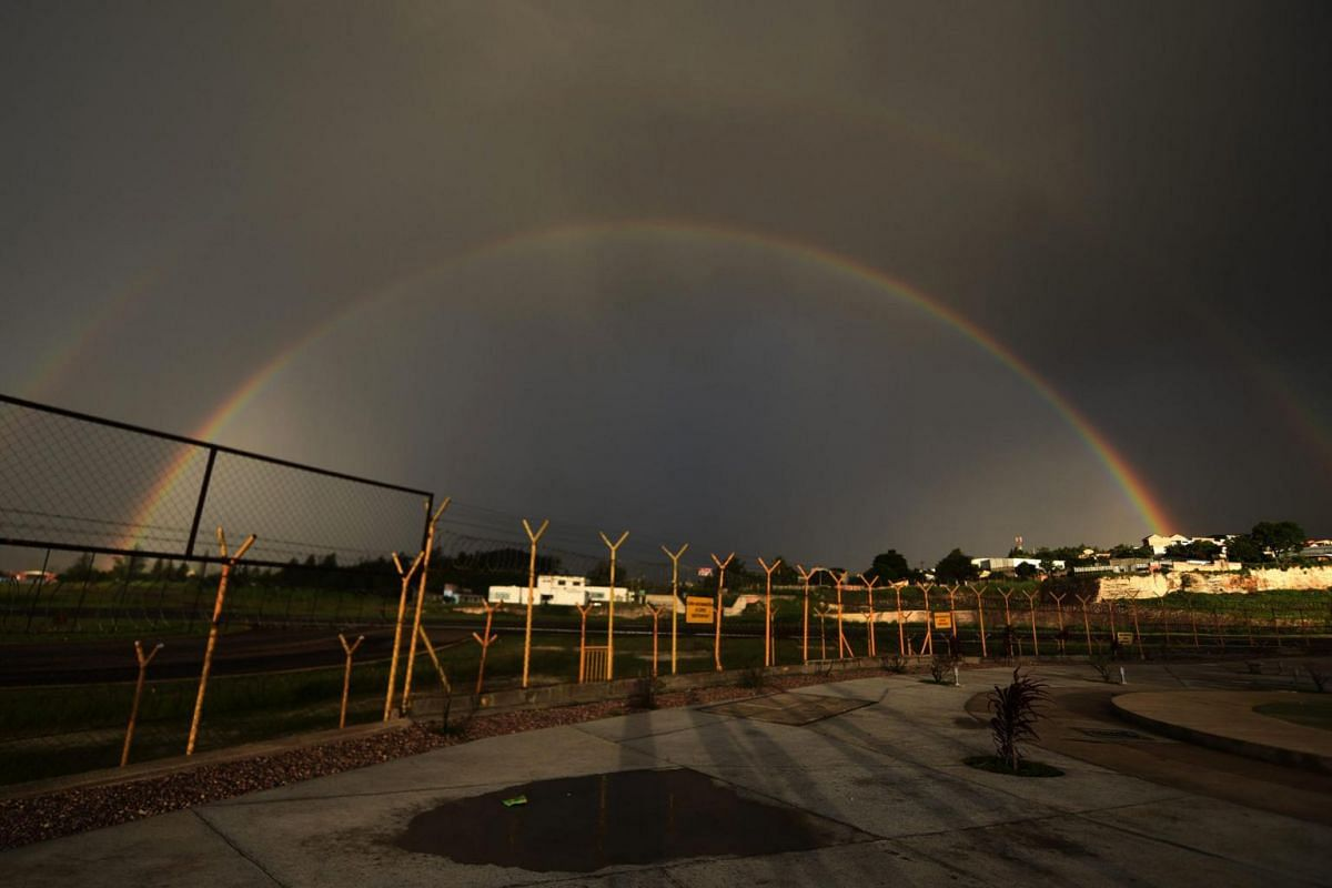 View of a double rainbow at Toncontin international airport in Tegucigalpa, on July 4, 2018.