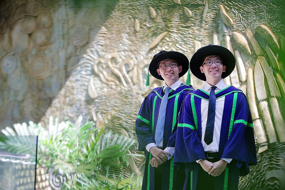 2018: Xin Xiang (left) and Xin Shan are currently research fellows at NUS' Department of Biological Sciences. Identical twins Lim Xin Xiang (left) and Lim Xin Shan will graduate with PhDs in biological sciences at the same ceremony come Friday. The 3