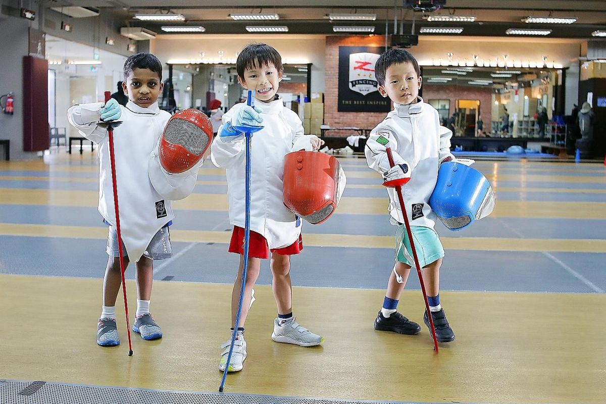 Nicole Elizabeth Tay and David James Tay are enrolled in Ready Steady Go Kids, a multi-sport programme for children. Eight-year-old Ted Ng goes to the same CrossFit gym as his dad Ng Eng Chuan. (From left) Six-year-olds Sabari Naidu, Max Cheong and W